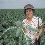 Farida-Jhabvala-Romero-reporting-in-Mendota-CA-broccoli-field-150x150