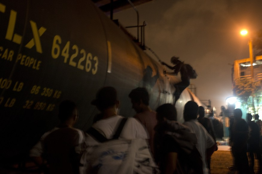Migrants boarding the freights trains in Coatzacolacos, Veracruz. Migrants use the trains to travel to the US when they do not have money to pay for local buses, or because they are afraid of immigration officials, who check buses to see for undocumented travelers.