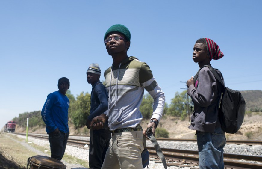 A group of migrants wait for the freight train in the outskirts of Mexico City. Many Garifunas (Central Americans of African descent) are leaving Honduras due to the increased of violence and lack of job opportunities. In this group of 5 people, 3 where minors.