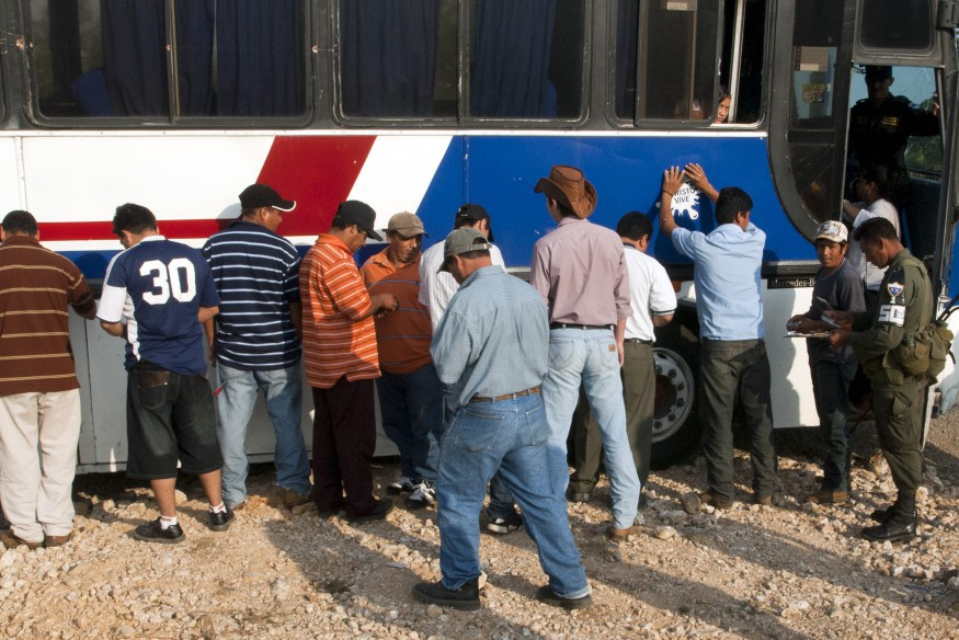 A local bus is stopped by the army. Check point like these typically look for drugs, guns and undocumented migrants.