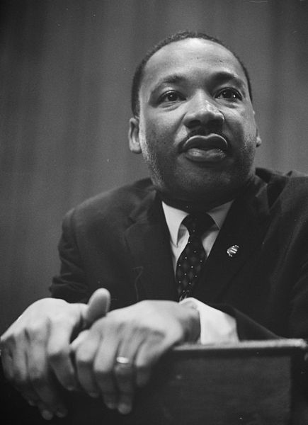 435px-Martin-Luther-King-1964-leaning-on-a-lectern