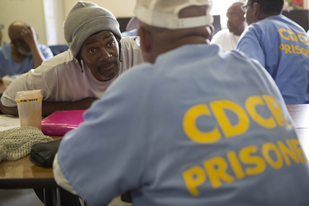 Jeffrey Ratchford discusses healthy foods for a diabetic to eat with another inmate during a diabetes education class at San Quentin Prison.