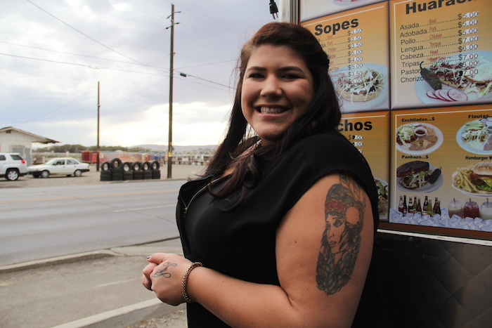 A woman with a tattoo of a Native woman orders at a Toppenish taco truck.