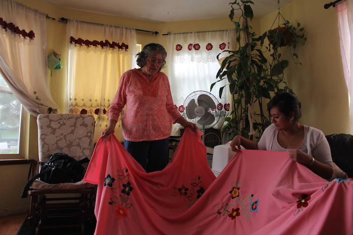 "Guadalupe Marquez teaches her mixed Native-Latina granddaughter Rena Marquez to ""bordar"" (to make traditional Mexican embroidery)."