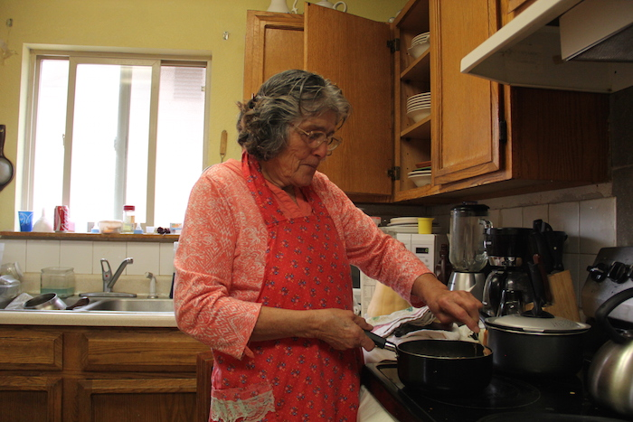 Guadalupe Marquez makes tortillas in her home in Toppenish, the largest town on the Yakama Nation.