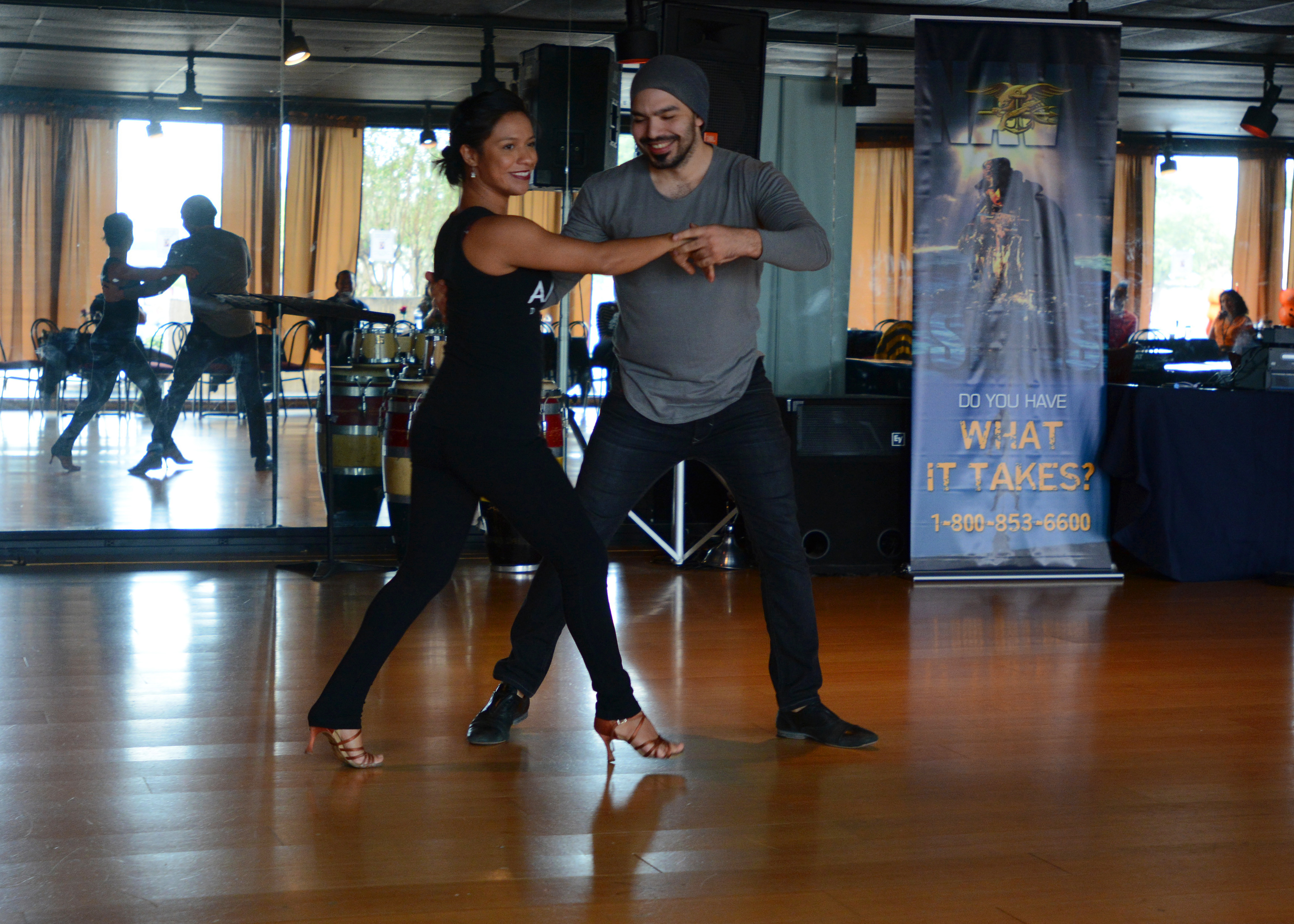 Salomon Amaya, owner of Amaya Dance, performs with his assistant Daisy Aguilar during the Navy and Amaya Dance salsa workshop Oct. 23. The beneft promoted salsa dancing as a way to help cope with combat related or general axiety issues affecting active-duty servicemembers in the Houston area and to raise money for future salsa events.  Navy Recruiting District Houston took lead on the event. (U.S. Navy photo by Mass Communication Specialist 1st Class Chris Fahey/RELEASED).