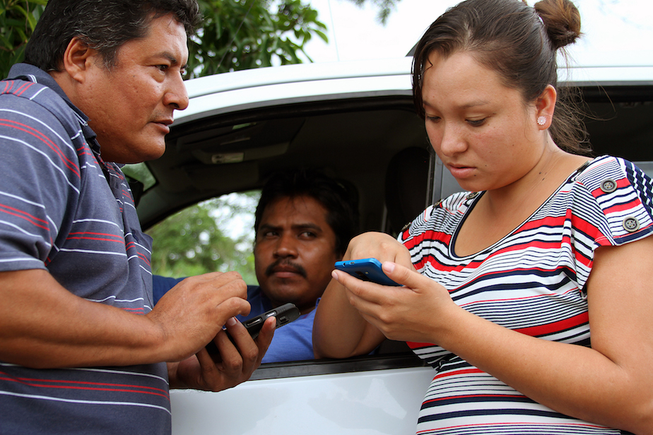 Miguel Ángel Jiménez Blanco and co-workers exchange video testimonies of vote buying in the San Marcos, Guerrero (June 2015).