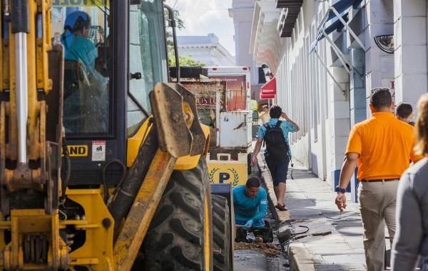SAN JUAN, PUERTO RICO - NOVEMBER 14:   Public water utility workers fix a pipe in Old San Juan on November 14, 2013 in San Juan, Puerto Rico, are just one of the about 250,000 public workers on and island of 3.8 million.The Government remains the largest employer in Puerto Rico and can only service about 11 percent of the pension costs out of it's budget. The island-territory of the United States is on the brink of a debt crisis as lending has skyrocketed in the last decade with the government issuing municipal bonds mostly to finance pensions. Market analysts have rated those bonds as junk and suspect it's 70 billion dollar debt might be unserviceable in the near future.  (Photo by Christopher Gregory/Getty Images)