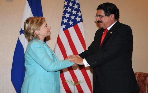 Honduras' President Manuel Zelaya (R) shakes hands with US Secretary of State Hillary Clinton before she leaves after attending the 39th General Assembly of the Organization of American States, in San Pedro Sula, 250 km north of Tegucigalpa on June 2, 2006.  AFP PHOTO/Orlando Sierra (Photo credit should read ORLANDO SIERRA/AFP/Getty Images)