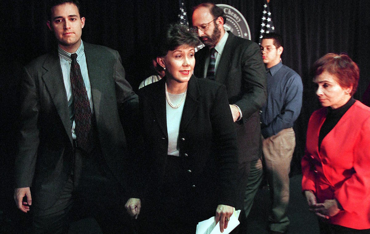WASHINGTON, : Linda Chavez (C), US President-elect George W. Bush's labor secretary pick, departs a press conference after withdrawing from the nomination process 09 January 2001 in Washington, DC, amid accusations that she harbored an illegal immigrant from Guatemala in direct violation of US law. From left are: Chavez's son David Gersten, Chavez, husband Chris Gersten, and supporters Josh Iturrino and Margarita Vallarades. (FILM) AFP PHOTO/Mario TAMA (Photo credit should read MARIO TAMA/AFP/Getty Images)