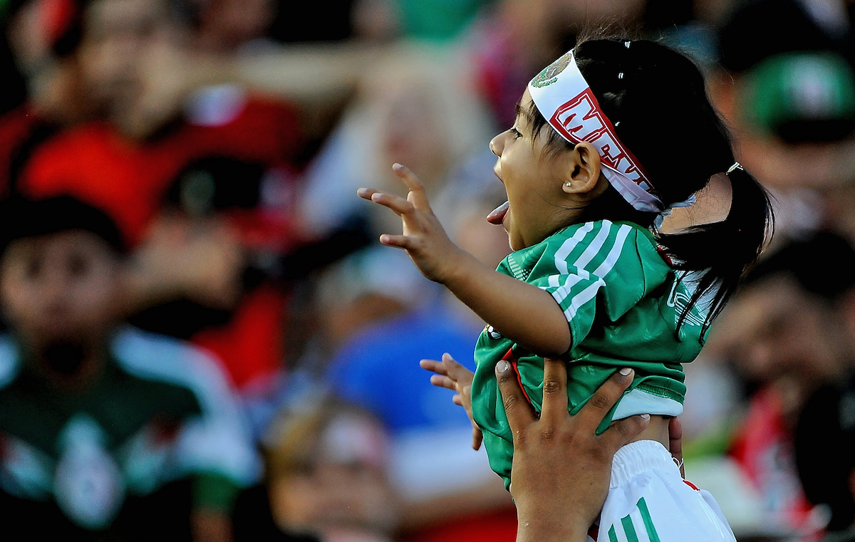 PASADENA, CA - OCTOBER 10:  A young fan of Mexico in the stands before the 2017 FIFA Confederations Cup Qualifier at Rose Bowl on October 10, 2015 in Pasadena, California.  (Photo by Jonathan Moore/Getty Images)