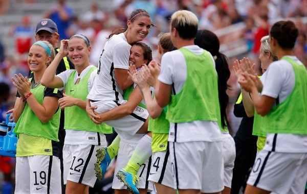 BIRMINGHAM, AL - SEPTEMBER 20:  Alex Morgan #13 of the United States of America celebrates after scoring against Haiti with Tobin Heath #17 during the US Women's 2015 World Cup victory tour match at Legion Field on September 20, 2015 in Birmingham, Alabama.  (Photo by Kevin C. Cox/Getty Images)