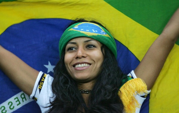 FRANKFURT/MAIN, Germany:  A Brazilian supporter waits with her national national flag for start of the final match of the 2005 FIFA football Confederations Cup Brazil vs Argentina at the Waldstadion Frankfurt 15 June 2005. AFP PHOTO OLIVER LANG  (Photo credit should read OLIVER LANG/AFP/Getty Images)