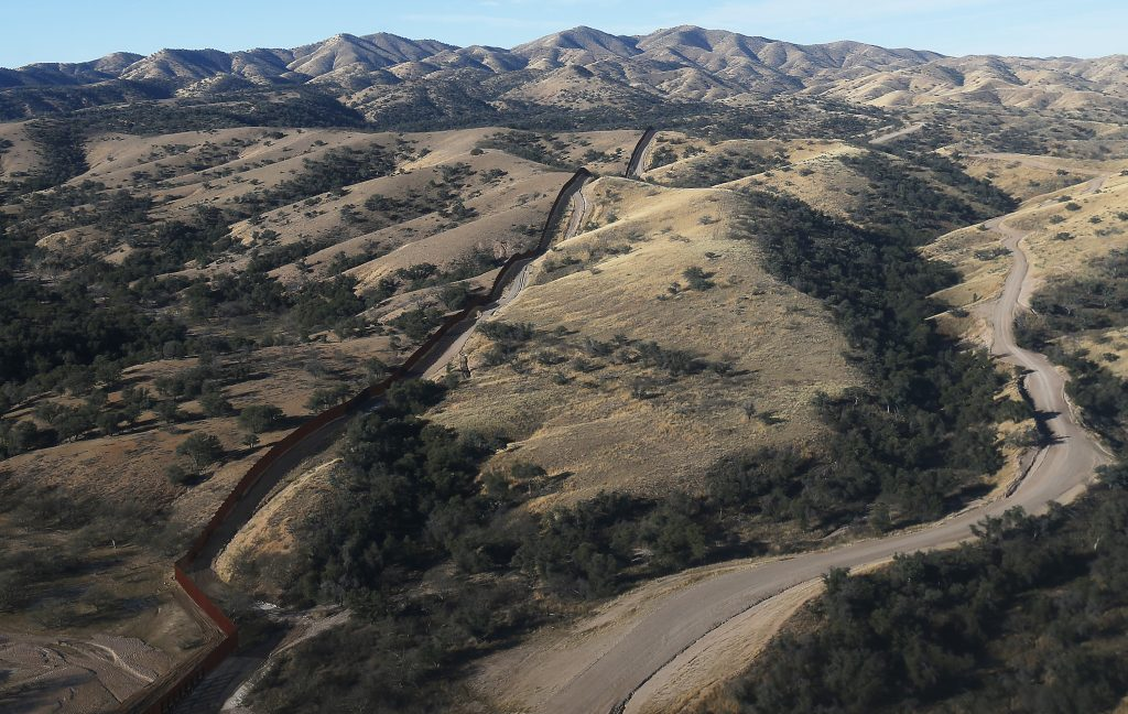 The international border fence as seen from the air west of Nogales, Arizona. (Mike Christy/Arizona Daily Star)