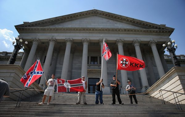 COLUMBIA, SC - JULY 18:  Ku Klux Klan members take part in a Klan demonstration at the state house building on July 18, 2015 in Columbia, South Carolina. The KKK protested the removal of the Confederate flag from the state house grounds and hurled racial slurs at minorities as law enforcement tried to prevent violence between the opposing groups.  (Photo by John Moore/Getty Images)