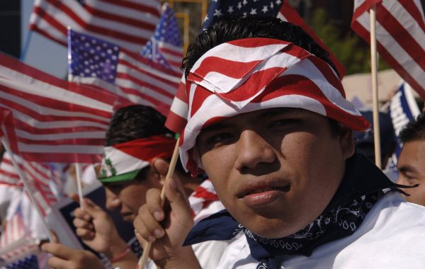 DALLAS - APRIL 9:  Luis Navarro and other protesters assemble as they wait for the Mega March on City Hall to begin April 9, 2006 in Dallas, Texas. According to reports, an estimated half million Hispanics participated in the Mega March to peacefully protest immigration reform.  (Photo by Jensen Walker/Getty Images)