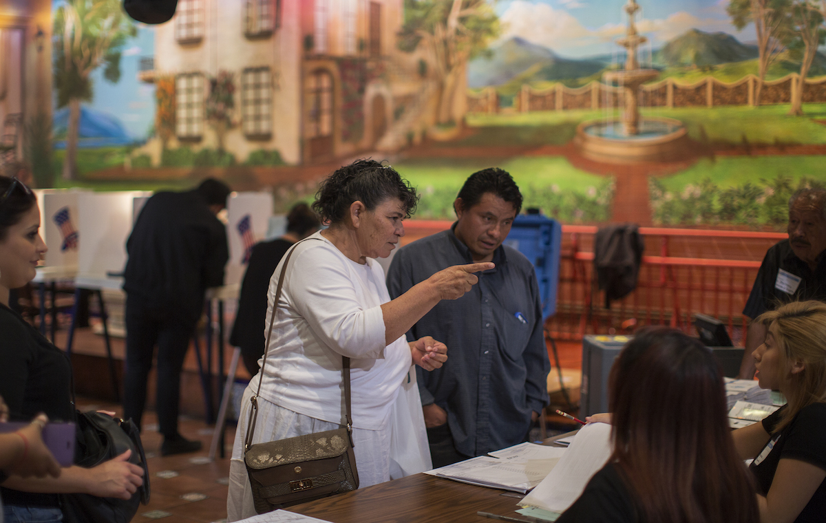 LOS ANGELES, CA - NOVEMBER 08: Latinos vote at a polling station in El Gallo Restaurant on November 8, 2016 in the Boyle Heights section of Los Angeles, California. In addition to choosing between Republican Donald Trump or Democrat Hillary Clinton for President of the United States, Californians are deciding on 17 ballot propositions.   (Photo by David McNew/Getty Images)