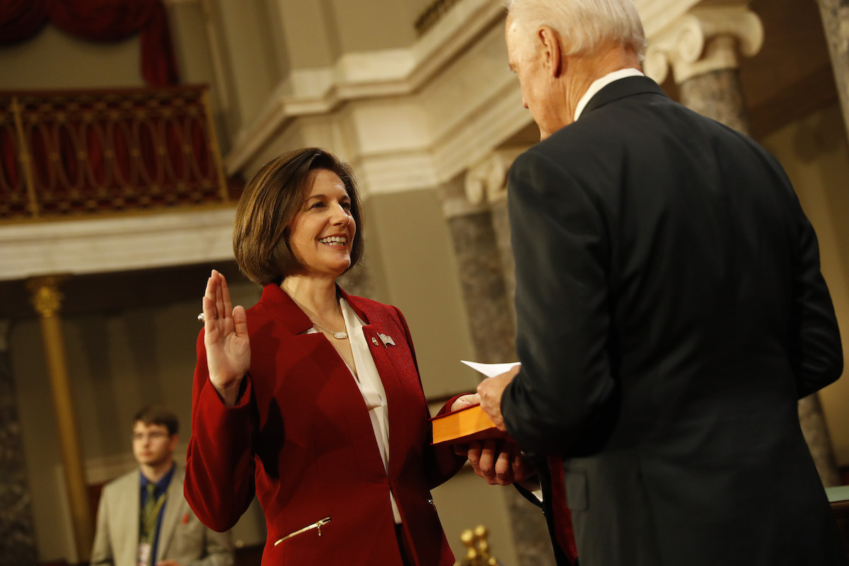 WASHINGTON, DC - JANUARY 3: U.S. Sen. Catherine Cortez Masto (D-NV) participates in a reenacted swearing-in with U.S. Vice President Joe Biden in the Old Senate Chamber at the U.S. Capitol January 3, 2017 in Washington, DC. Earlier in the day Biden swore in the newly elected and returning members on the Senate floor. (Photo by Aaron P. Bernstein/Getty Images)