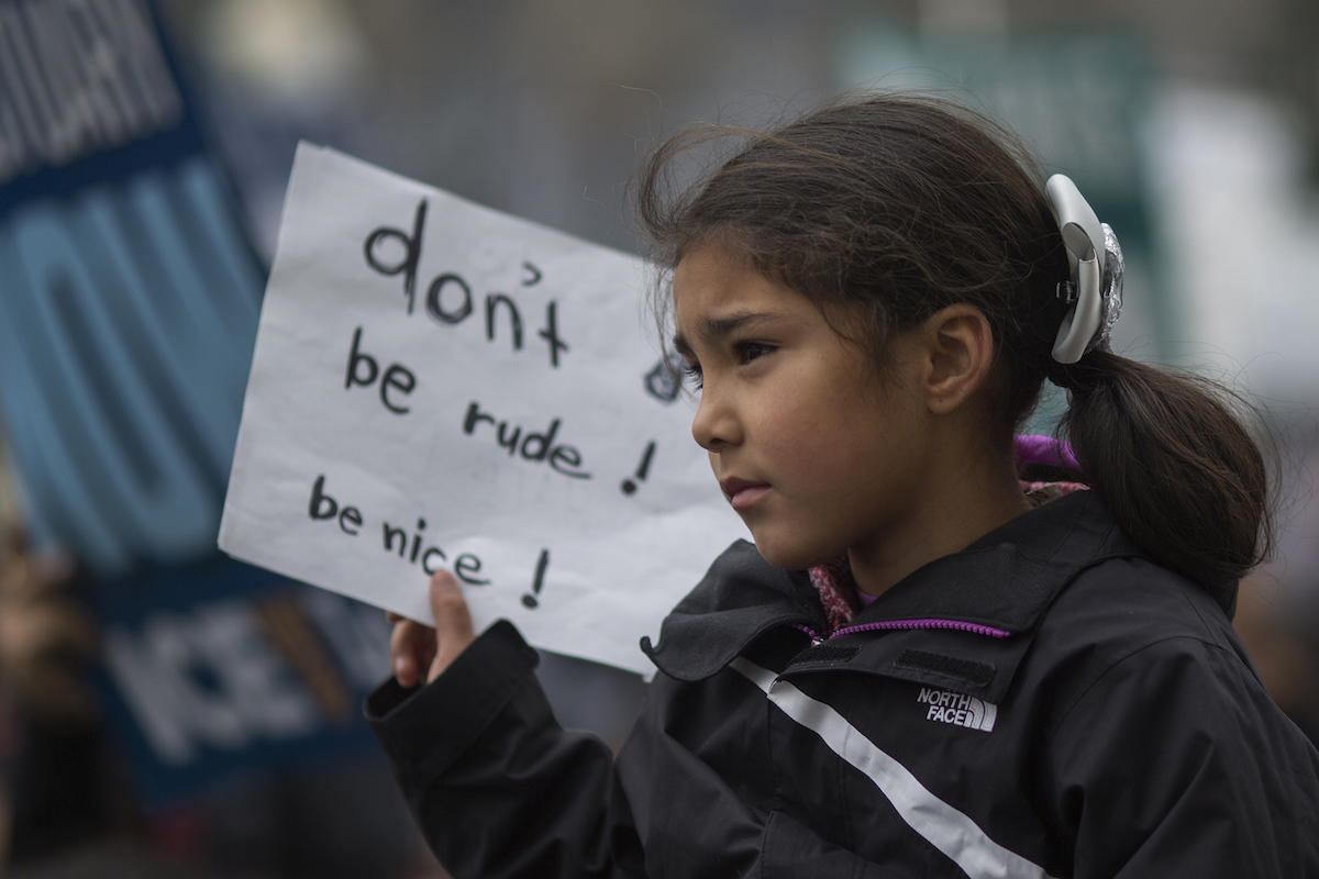LOS ANGELES, CA - FEBRUARY 18: A girl carries a sign in the Immigrants Make America Great March to protest actions being taken by the Trump administration on February 18, 2017 in Los Angeles, California. Protesters are calling for an end to stepped up ICE raids and deportations, and that health care be provided for documented and undocumented people. (Photo by David McNew/Getty Images)